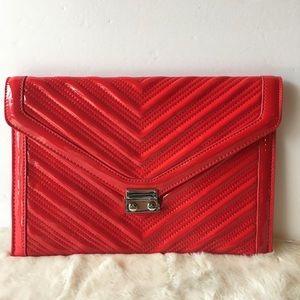 BCBG red patten leather clutch